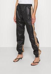 H2O Fagerholt - ALWAYS TRACK PANTS - Tracksuit bottoms - black - 1