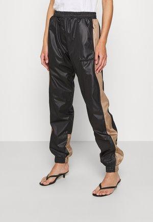 ALWAYS TRACK PANTS - Jogginghose - black