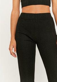 TALLY WEiJL - Trousers - black - 3