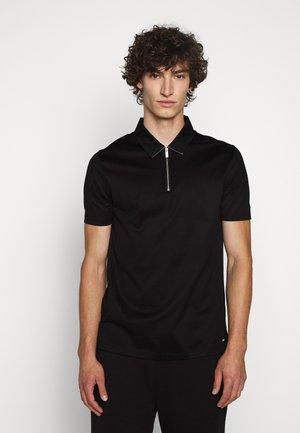 DASILI - Polo shirt - black