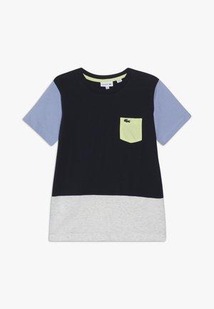 ROLLIS - T-shirt z nadrukiem - navy blue/grey