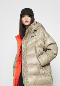 Nike Sportswear - PARKA - Down coat - mystic stone/bright crimson/black