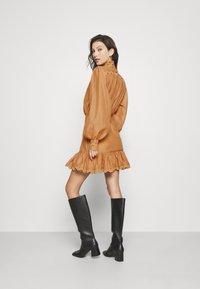 Missguided - PREMIUM BALLOON SLEEVE FRILL HEM MINI - Day dress - beige - 2