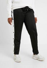 Urban Classics Curvy - LADIES BUTTON UP TRACK PANTS - Pantalones deportivos - black - 0