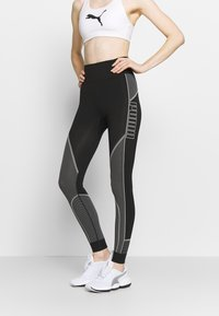 Puma - EVOSTRIPE EVOKNIT LEGGINGS - Tights - black - 0