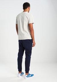 Nike Sportswear - CLUB JOGGER - Tracksuit bottoms - blue - 2