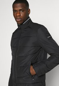 Calvin Klein - QUILTED JACKET - Light jacket - black - 3