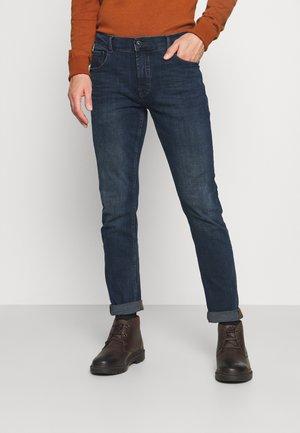 TOMY JOY POWEFLEX - Slim fit jeans - dark blue denim
