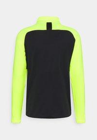 Nike Performance - DRY PAD ACADEMY WINTERIZED - Fleece jumper - black/volt/silver - 1