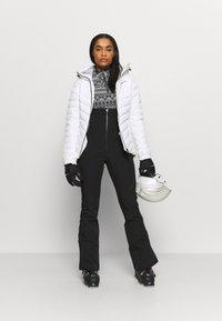Spyder - STRUTT - Pantalón de nieve - black - 1