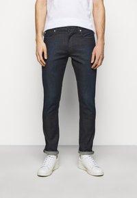Emporio Armani - POCKETS PANT - Slim fit jeans - dark blue denim - 0
