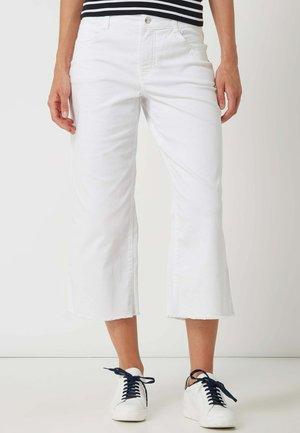 GRETA - Flared Jeans - weiß