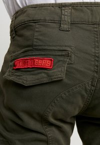 Alpha Industries - PETROL PATCH - Cargo trousers - greyblack - 4