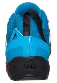 adidas Performance - TERREX SWIFT SOLO HIKING SHOES - Hiking shoes - dark solar blue/black - 1