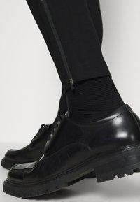 Bruuns Bazaar - POLITAN ZIP PANTS - Trousers - black - 3