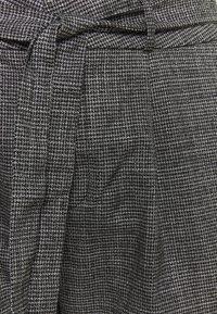 Vero Moda Curve - VMEVA LOOSE PAPERBAG AMY PANT - Trousers - black/grey/ white - 2
