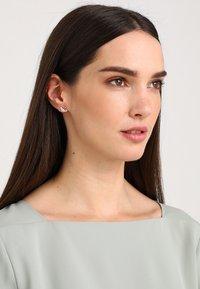 Swarovski - SWAN MINI  - Earrings - rosegold-coloured - 1