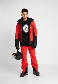 Halti - PUNTTI PANTS - Snow pants - lava red - 1