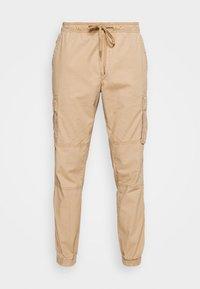 JOGGER - Pantalones cargo - mojave