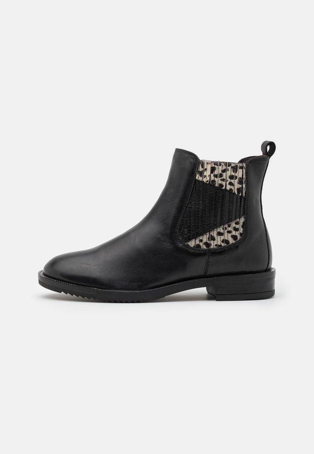 Korte laarzen - nero/bianco