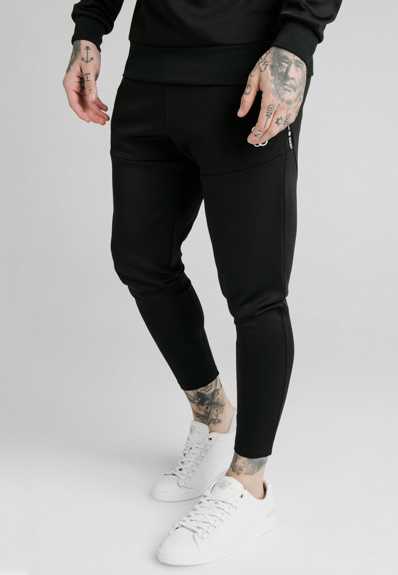 SIKSILK - FUNCTION TRACK PANTS - Jogginghose - black