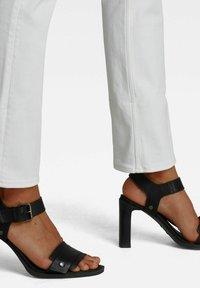 G-Star - NOXER  - Straight leg jeans - white - 3
