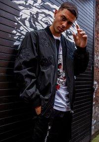 Ed Hardy - DRAG-CLOUD NYLON BOMBER JACKET - Summer jacket - black - 4