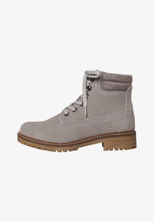 STIEFELETTE - Platform ankle boots - light grey