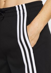 adidas Performance - PANT - Pantalon de survêtement - black/white - 4