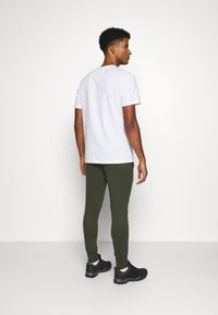 Jack & Jones - JJWILL PANTS - Tracksuit bottoms - forest night - 2