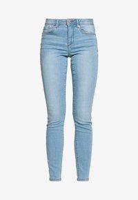 VMTANYA PIPING - Slim fit jeans - light blue denim