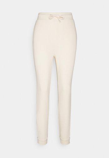 SLIM FIT SWEAT JOGGERS  - Pantalones deportivos - off-white