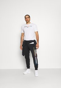 Under Armour - PRIDE COURAGE - Print T-shirt - white - 1