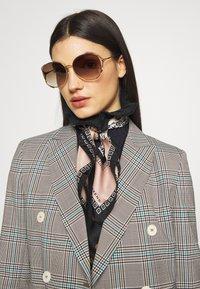 Gucci - Sunglasses - gold-coloured/brown - 1