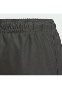 adidas Performance - Swimming shorts - black - 2