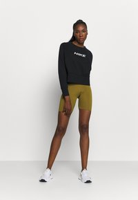 Nike Performance - ONE SHORT - Legging - olive flak/white - 1