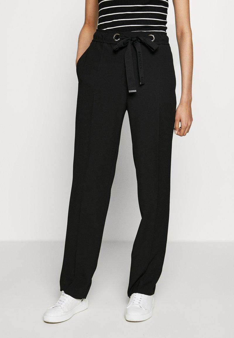 HUGO - HILIKA - Trousers - black