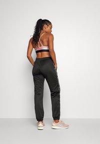 Champion - ELASTIC CUFF PANTS - Tracksuit bottoms - black - 2