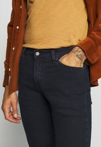 Levi's® - 511™ SLIM - Jeans slim fit - black - 4