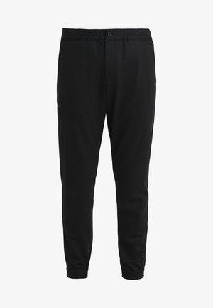 TERRANCE - Trousers - black