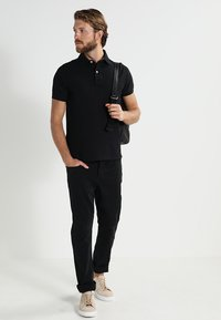Tommy Hilfiger - PERFORMANCE SLIM FIT - Piké - black - 1