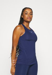 Nike Performance - TANK ALL OVER  - T-shirt de sport - binary blue/white - 0