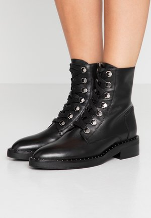 NEW FASHION STREET - Lace-up ankle boots - black/silver