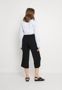 ONLY - ONLNOVA LIFE CROP PALAZZO PANT - Trousers - black - 2