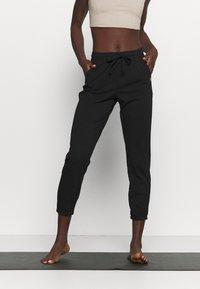 Deha - PANTS - Tracksuit bottoms - black - 0