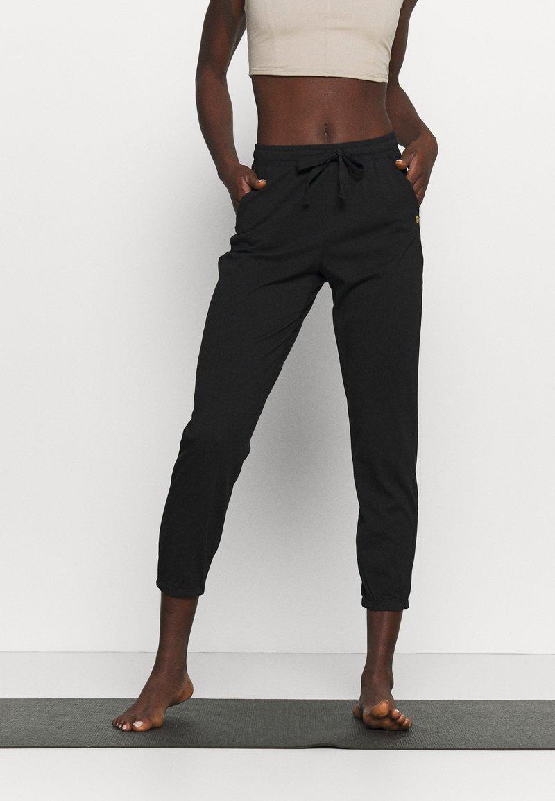 Deha - PANTS - Tracksuit bottoms - black