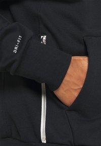 Nike Performance - ISSUE HOODIE - Zip-up sweatshirt - black/pale ivory - 6