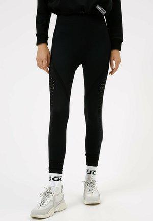 NIA - Leggings - Trousers - black