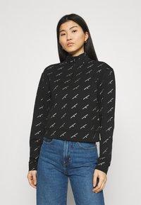Calvin Klein Jeans - LOGO HALF ZIP - Felpa - black - 0