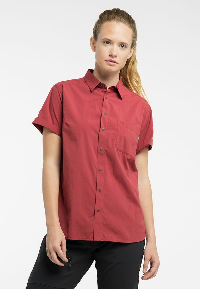 IDUN LITE SS SHIRT - Button-down blouse - brick red